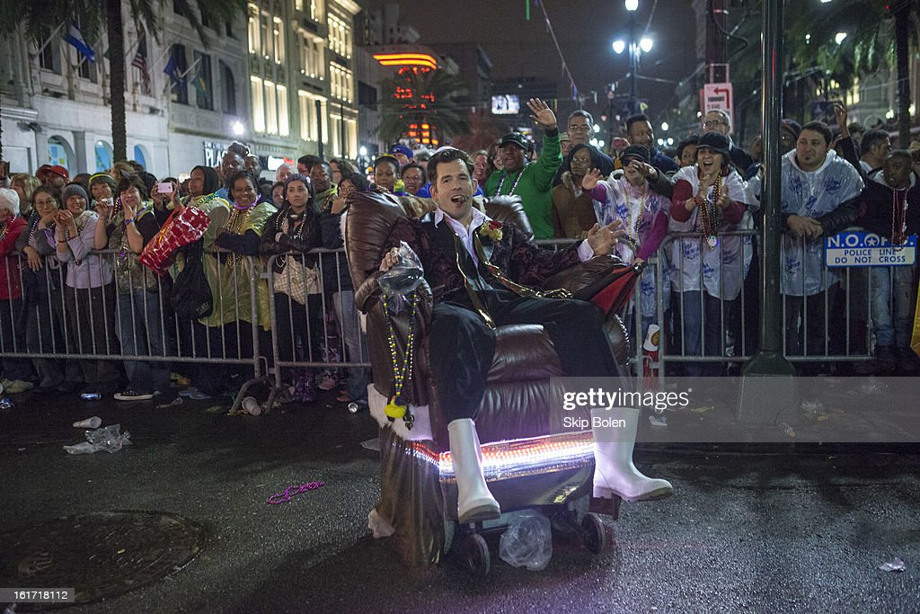 A member of the Laissez Boys in his custom motorized lounge chair rides in the 2013 Krewe of Orpheus Mardi Gras Parade on February 11, 2013 in New Orleans, Louisiana.