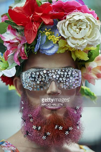 A member of the Lesbian Gay Bisexual and Transgender community takes part in the annual Pride Parade in London on June 27 2015 AFP PHOTO / NIKLAS...