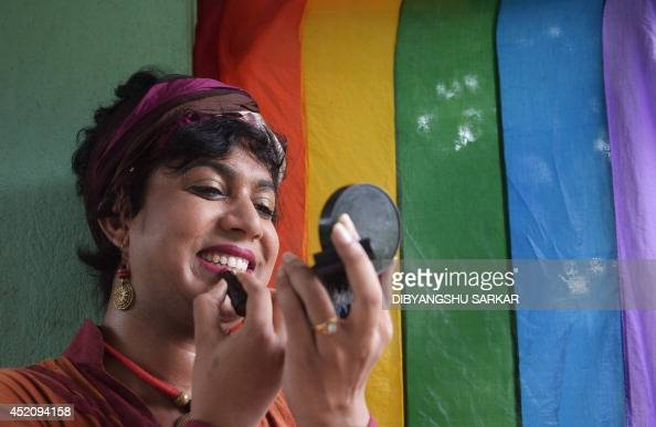 A member of the lesbian gay bisexual transgender community puts on makeup prior to a rally in Kolkata on July 13 2014 Hundreds of LGBT activists...