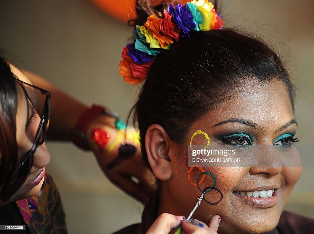 A member of the LGBT (Lesbian, Gay, Bi-sexual and Transgender) community has her face painted during the Rainbow Carnival in Kolkata on December 9, 2012. The day long carnival was organised to show solidarity for the cause and to raise voices for equal rights and against social discrimination. AFP PHOTO/Dibyangshu SARKAR