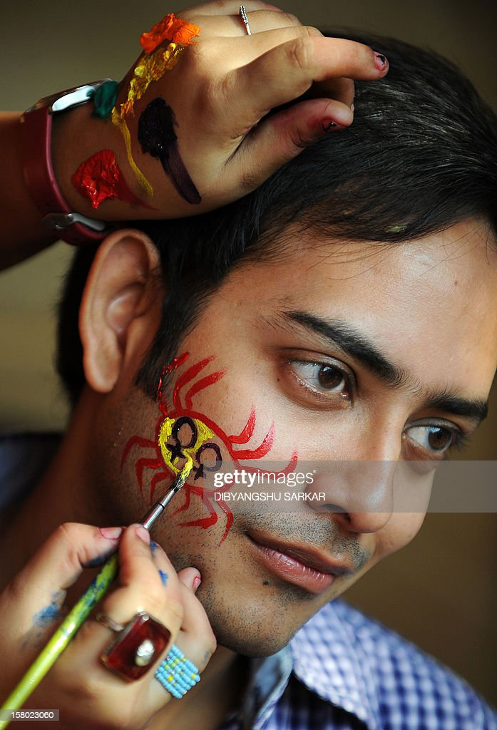 A member of the LGBT (Lesbian, Gay, Bi-sexual and Transgender) community has his face painted during the Rainbow Carnival in Kolkata on December 9, 2012. The day long carnival was organised to show solidarity for the cause and to raise voices for equal rights and against social discrimination. AFP PHOTO/Dibyangshu SARKAR