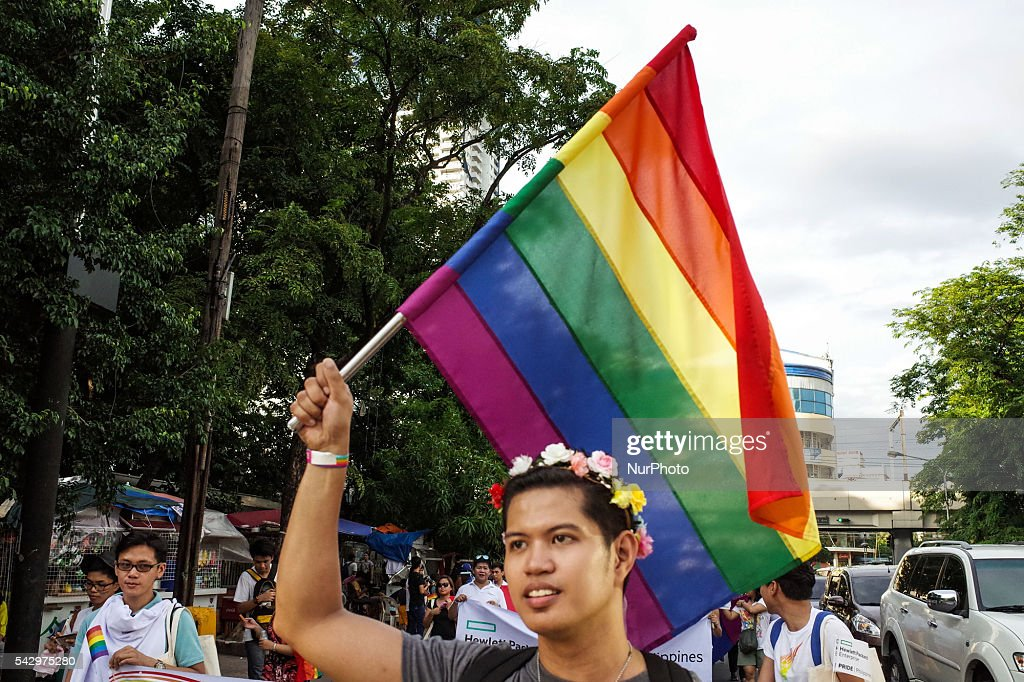 A member of the LGBT community holding a rainbow flag marches around Rizal Park in Manila on Saturday, 25 June 2016, during the annual LGBT pride parade. Hundreds of supporters and members of the lesbian, gay, bisexual, and transgender (LGBT) community paraded in Manila calling for the passage of an anti-discrimination law, as well as calling for justice for the shooting in a gay club in Orlando that left 53 people dead.