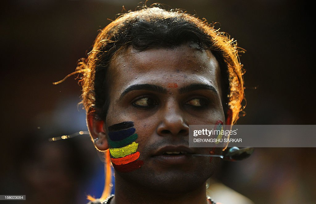 A member of the LGBT (Lesbian, Gay, Bi-sexual and Transgender) community participates in a game during the Rainbow Carnival in Kolkata on December 9, 2012. The day long carnival was organised to show solidarity for the cause and to raise voices for equal rights and against social discrimination. AFP PHOTO/Dibyangshu SARKAR