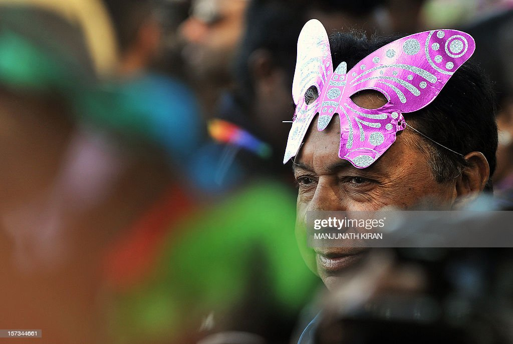 A member of the LGBT (Lesbian, Gay, Bi-sexual and Transgender) community takes part in the Bangalore Queer Pride Parade 2012 on December 2, 2012. The march marks the end of the annual 10-day Bengaluru Pride and Karnataka Queer Habba 2012. AFP PHOTO/Manjunath KIRAN