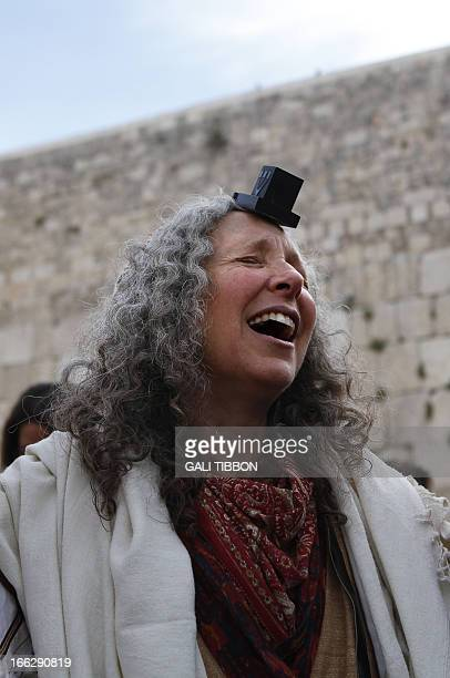 A member of the liberal religious group Women of the Wall wearing phylacteries and a 'Tallit' traditional Jewish prayer shawl for men prays at the...
