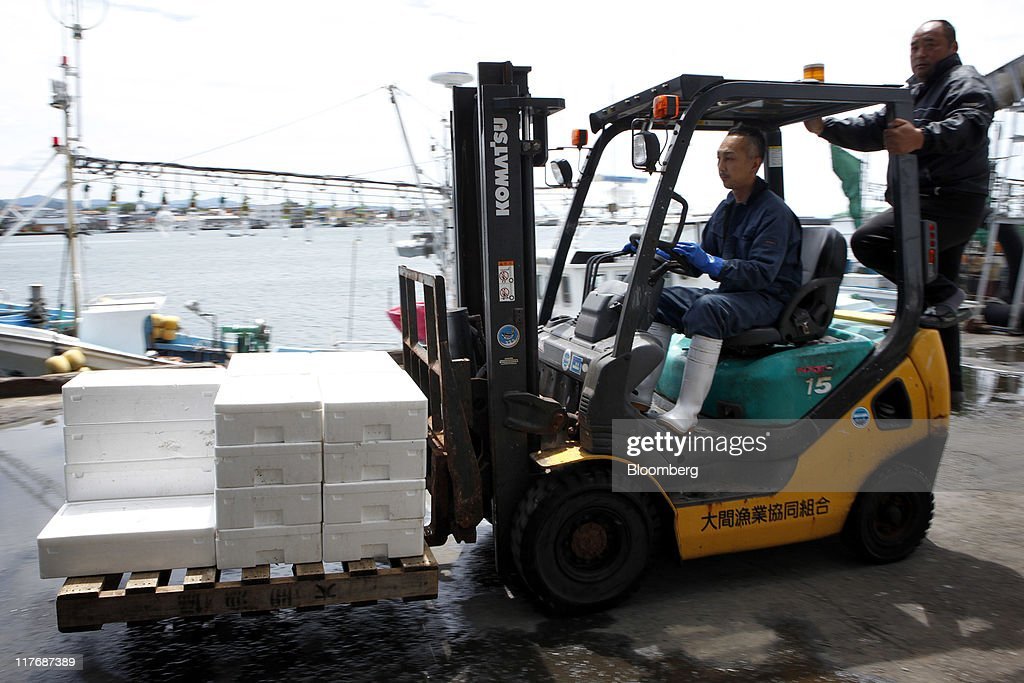 A member of the local fishing cooperative operates a forklift to carry boxes containing fish at a fishing port in Oma Town, Aomori Prefecture, Japan, on Sunday, June 26, 2011. Over the 29 years since Electric Power Development Co.'s (J-Power) nuclear plant was proposed, Oma has received almost 11 billion yen in subsidies, said Kenichi Ito, a town planning official. In Oma and other Aomori towns, the grants helped offset declining revenues that threatened the survival of rural communities, officials said. Photographer: Kiyoshi Ota/Bloomberg via Getty Images
