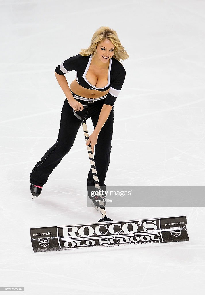 Member of the Los Angeles Kings ice girls Ashley Covert cleans the ice during the team's preseason game against the Colorado Avalanche at the MGM Grand Garden Arena on September 28, 2013 in Las Vegas, Nevada. Mello and fellow Ice Crew Girl Allison 'Ally' Mello team up to compete on the new season of the reality television game show 'The Amazing Race.'