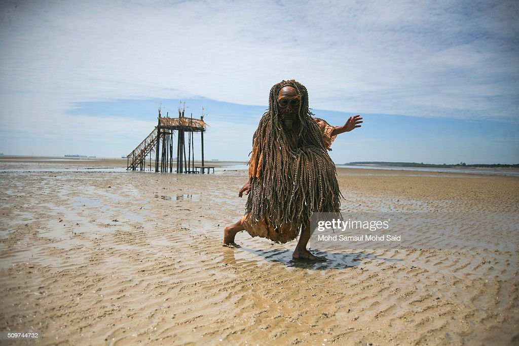 A member of the Mah Meri tribe wears a traditional costume and gestures on the beach after their 'Puja Pantai', a thanksgiving ritual to appease the spirits of the seas on February 12, 2016 in Pulau Carey, Malaysia. Every year, the indigenous people of Mah Meri village, located in Pulau Carey, about 140 km (87 miles) southwest of Kuala Lumpur, perform the 'Puja Pantai' ritual prayer and 'Main Jo-oh' dance to appease the spirits of the seas and celebrate the New Year.