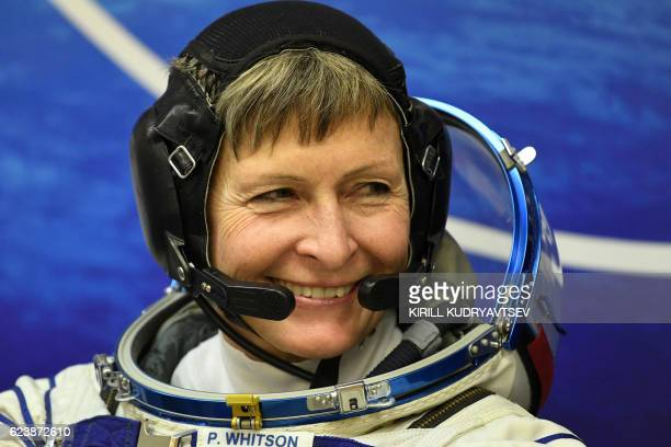 Member of the main crew of the 50/51 expedition to the International Space Station US astronaut Peggy Whitson looks on in her space suit at the...