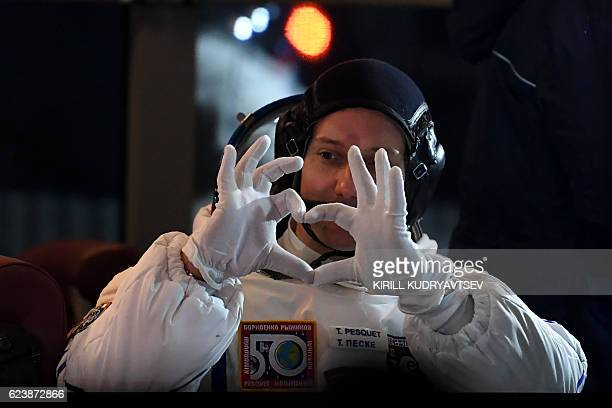 Member of the main crew of the 50/51 expedition to the International Space Station France's astronaut Thomas Pesquet makes a heart with his hands at...