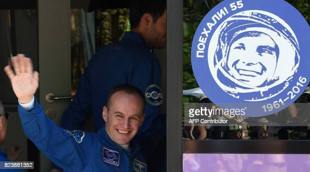 Member of the main crew of the 52 expedition to the International Space Station Russian cosmonaut commander Sergei Ryazansky waves to the crowd at...