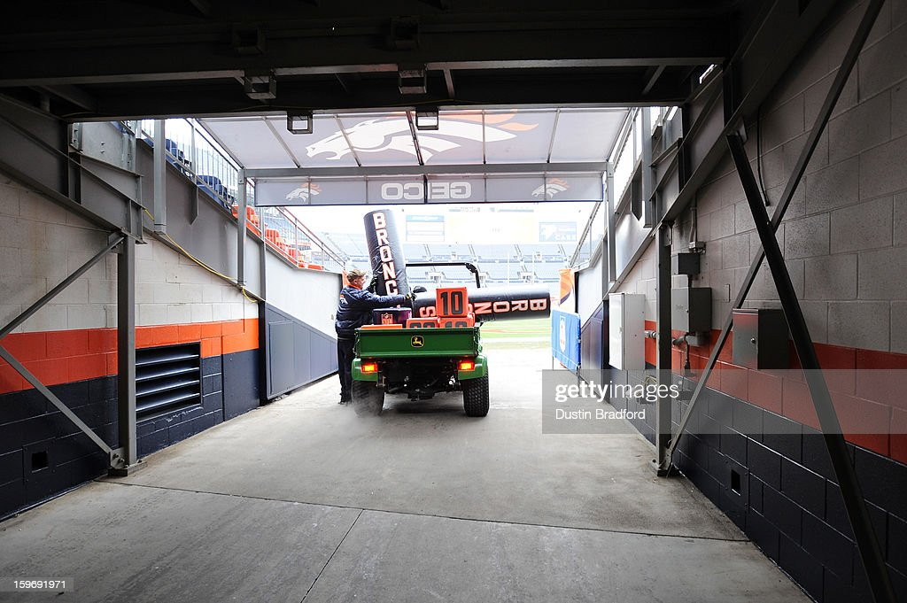 A member of the maintance grounds crew brings pads and pylons out to the field prior to the Denver Broncos hosting the Baltimore Ravens during the AFC Divisional Playoff Game at Sports Authority Field at Mile High on January 12, 2013 in Denver, Colorado.