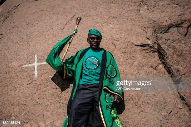 TOPSHOT A member of the Marikana community and members of the Association of Mineworkers gather to commemorate the fifth anniversary of the Marikana...