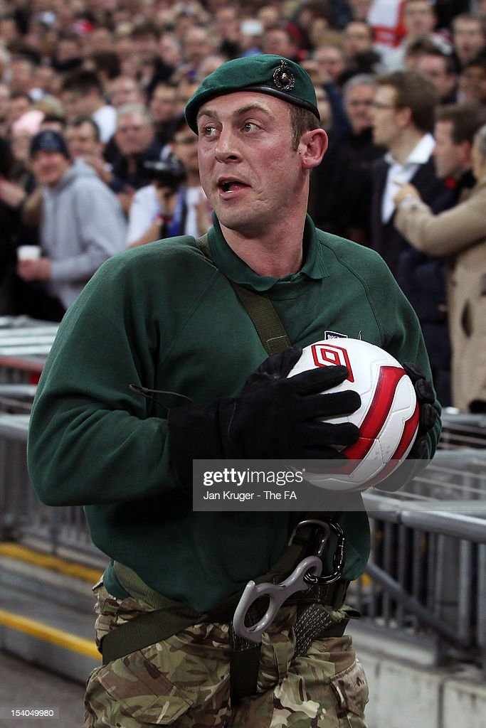 A member of the marines delivers the match ball during the FIFA 2014 World Cup Group H qualifying match between England and San Marino at Wembley Stadium on October 12, 2012 in London, England.