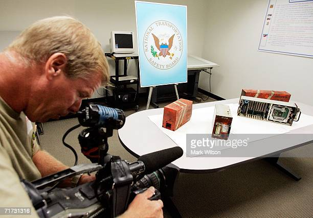 A member of the media films the cockpit voice recorder and the flight data recorder that was retrieved from Comair Flight 5191 at the National...