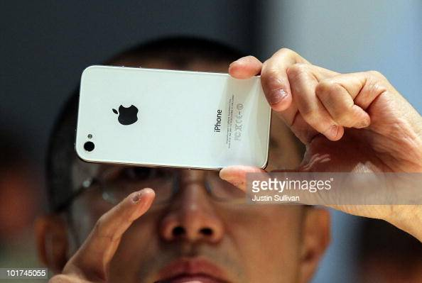 A member of the media inspects the new iPhone 4 at the 2010 Apple World Wide Developers conference June 7 2010 in San Francisco California Apple CEO...