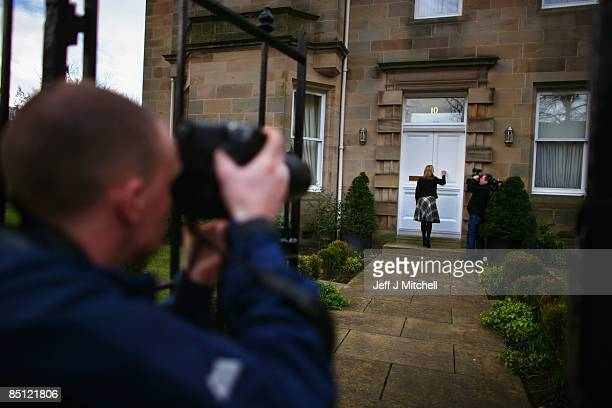 A member of the media knocks on the door of the Edinburgh home of the former chief executive of Royal Bank of Scotland Sir Fred Goodwin as a...