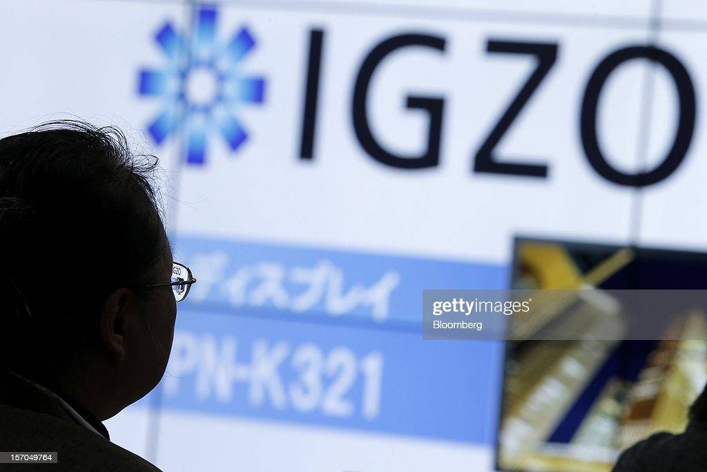 A member of the media listens during the unveiling of Sharp Corp.'s PN-K321, 32-inch 4K2K liquid crystal display (LCD) IGZO monitors in Tokyo, Japan, on Wednesday, Nov. 28, 2012. Sharp, Japan's largest maker of liquid-crystal displays, has lined up customers for its most advanced panels after saying earlier this year it was struggling to find buyers. Photographer: Kiyoshi Ota/Bloomberg via Getty Images