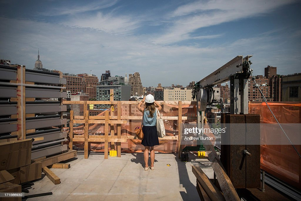 A member of the media photographs the view from the Whitney Museum of American Art's new building, which is still under construction, on June 26, 2013 in the Meat Packing District neighborhood of New York City. The museum, which is scheduled to open in 2015, will be nine stories tall and was designed by Renzo Piano Building Workshops. The estimated capital campaign, including building cost, endowments and the increase of instituional capacity, is $760 million.