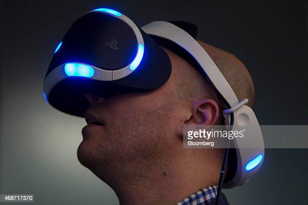A member of the media plays a video game using a Sony Computer Entertainment Inc Project Morpheus virtualreality headset during a demonstration in...