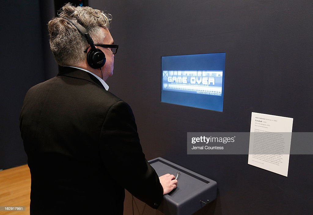 A member of the media plays 'Canabalt' which is one of the 14 video games that are part of the exhibiton 'Applied Designs' during the 'Applied Design' press preview at The Museum of Modern Art on March 1, 2013 in New York City.