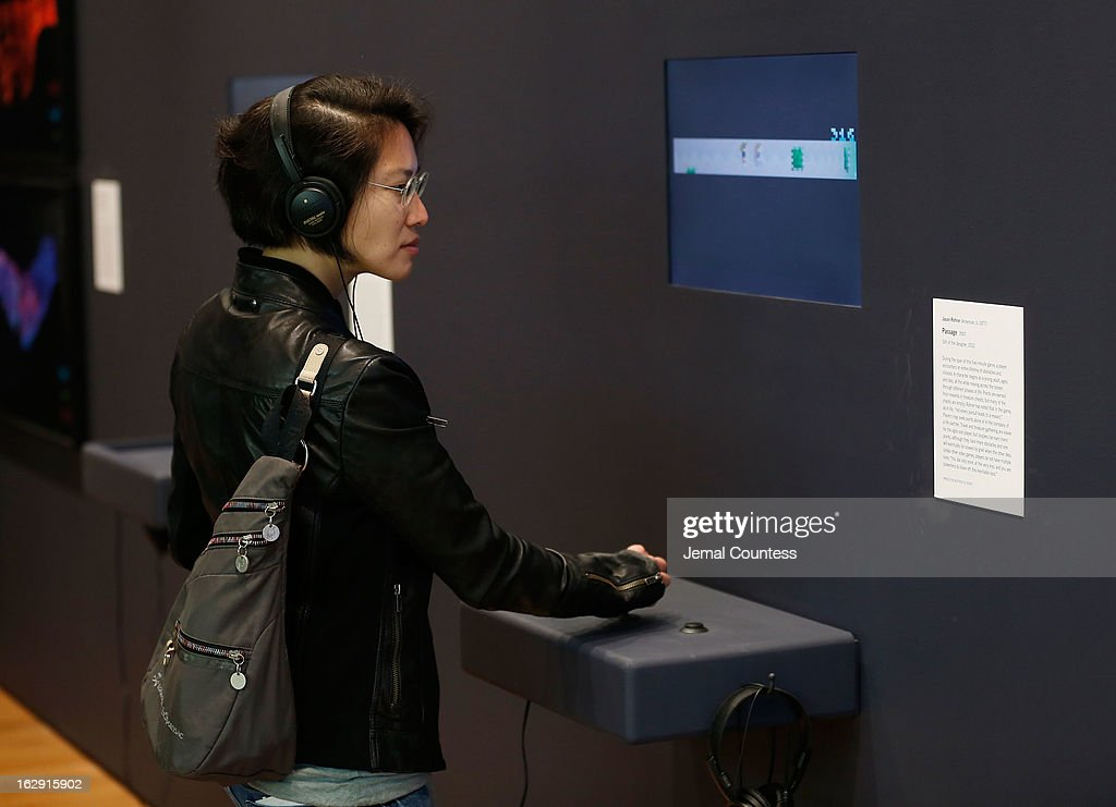 A member of the media plays one of the 14 video games that are part of the exhibiton 'Applied Designs' during the 'Applied Design' press preview at The Museum of Modern Art on March 1, 2013 in New York City.