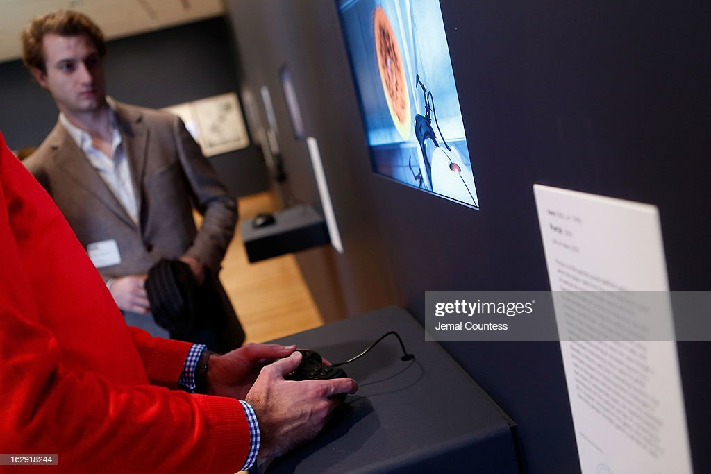 A member of the media plays 'Portal' which is one of the 14 video games that are part of the exhibiton 'Applied Designs' during the 'Applied Design' press preview at The Museum of Modern Art on March 1, 2013 in New York City.