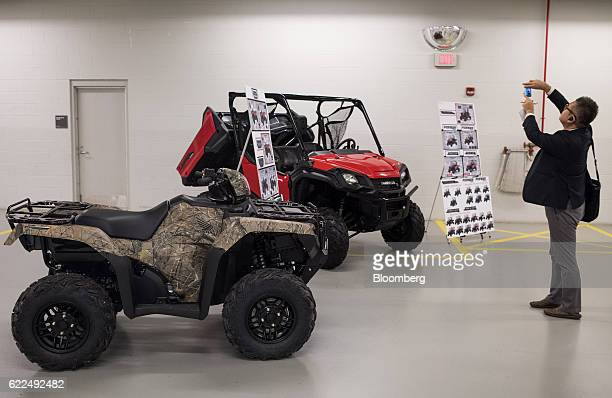 A member of the media takes a photograph of Honda Motor Co off road vehicles at the Honda Research Development Americas Inc center in Raymond Ohio US...