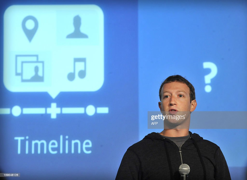 A member of the media takes pictures of Facebook CEO Mark Zuckerberg as he speaks at an event at Facebook's headquarters office in Menlo Park, California, on January 15, 2012. Today, Facebook announced the limited beta release of Graph Search, a feature that will create a new way for people to navigate connections and search social networks. AFP PHOTO Josh Edelson