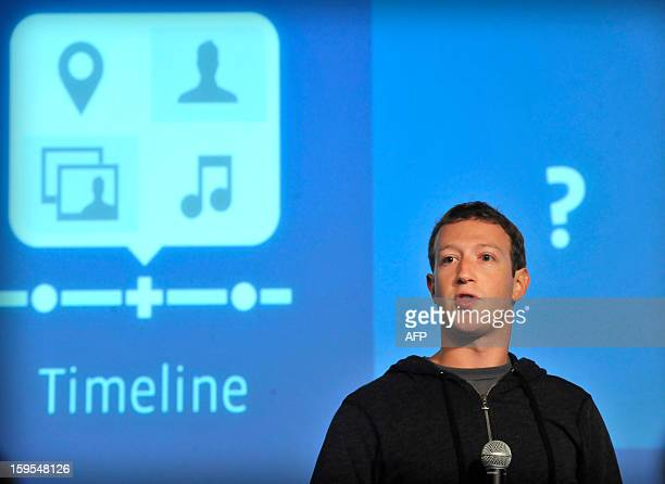 A member of the media takes pictures of Facebook CEO Mark Zuckerberg as he speaks at an event at Facebook's headquarters office in Menlo Park...
