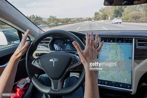 A member of the media test drives a Tesla Motors Inc Model S car equipped with Autopilot in Palo Alto California US on Wednesday Oct 14 2015 Tesla...