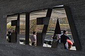 Member of the media wait next to a logo of the Worlds football governing body at the FIFA headquarters in Zurich prior to a press conference of FIFA...