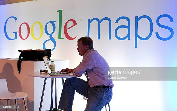 A member of the media works on a laptop before the start of a news conference about Google Maps on June 6 2012 in San Francisco California Google...