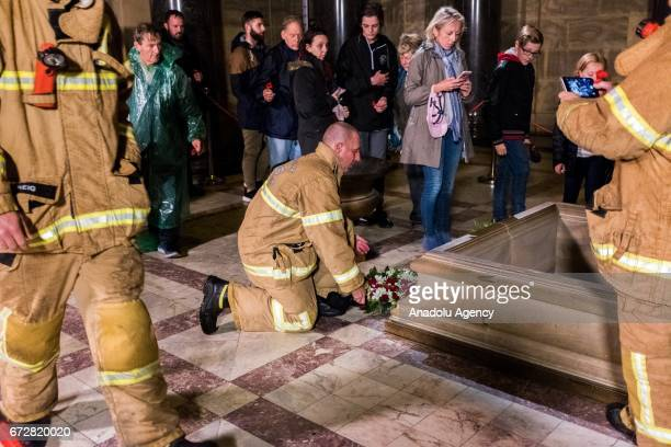 A member of the Melbourne Fire brigade lays a wreath during the dawn service of the ANZAC day commemoration at the Shrine of Remembrance in Melbourne...