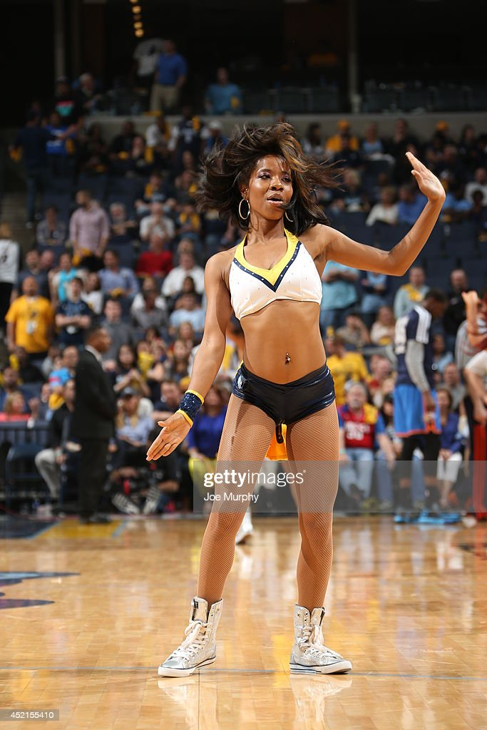 A member of the Memphis Grizzlies cheerleading team performs for the crowd in Game Six of the Western Conference Quarterfinals between the Oklahoma City Thunder and the Memphis Grizzlies during the 2014 NBA Playoffs on May 3, 2014 at FedExForum in Memphis, Tennessee.