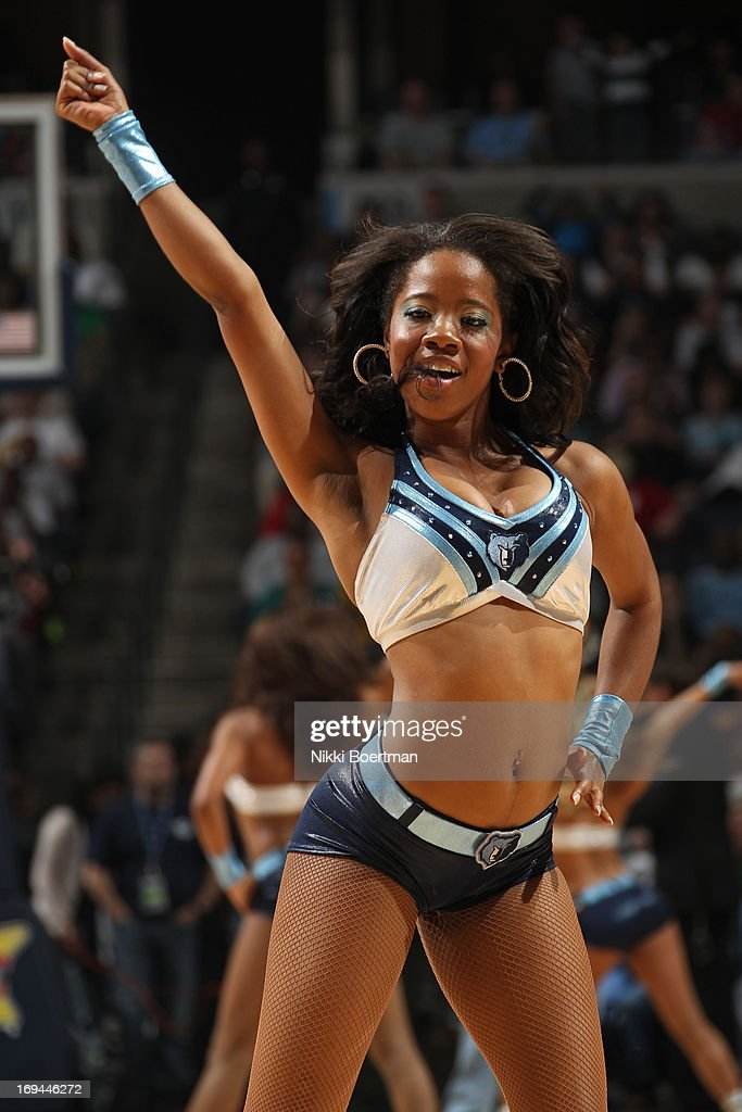 A member of the Memphis Grizzlies Dance Team cheers on against the Los Angeles Clippers on April 13, 2013 at FedExForum in Memphis, Tennessee.