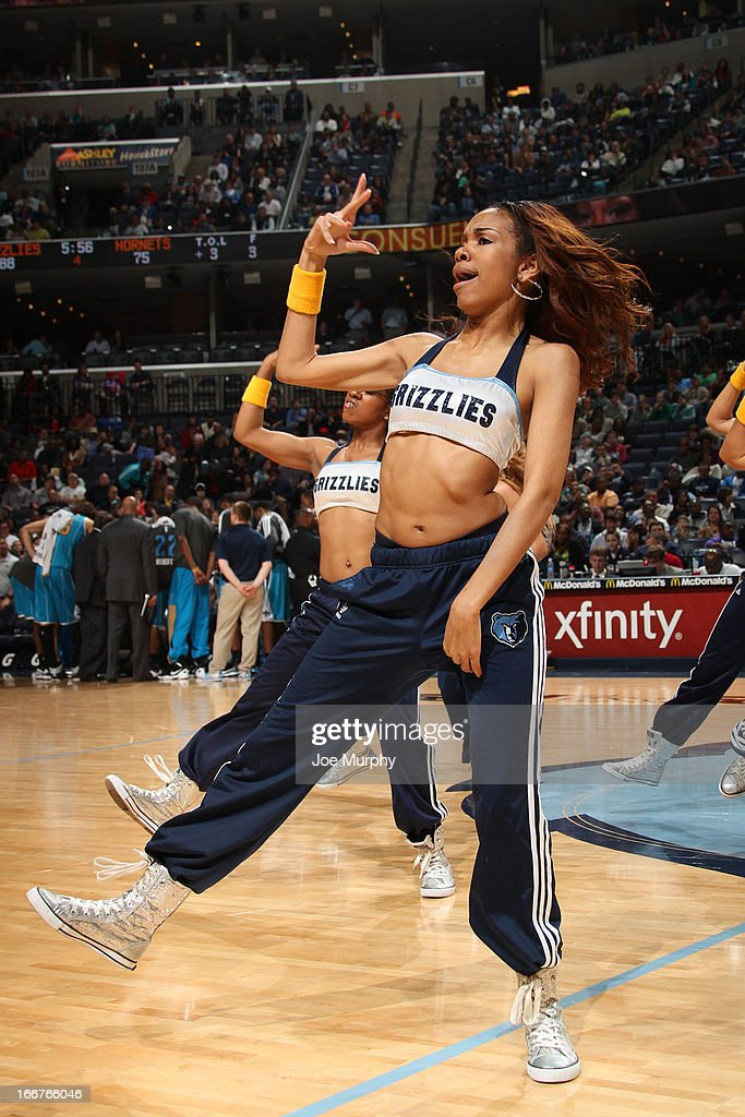 A member of the Memphis Grizzlies dance team performs during halftime in a game against the New Orleans Hornets on March 9, 2013 at FedExForum in Memphis, Tennessee.