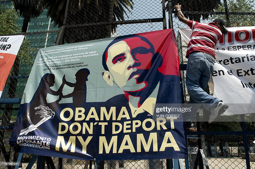 A member of the Meso-American Migrant Movement hangs banner in front of the US embassy in Mexico City during a protest to demand the deportation of Mexicans from the US to stop, on May 2, 2013. Migration will be among the top issues when US President Barack Obama visits Mexico and Costa Rica this week, and many in the region hope Washington will finally act to give 11 million undocumented workers a path to citizenship. Obama headed to Mexico on Thursday to put trade back at the heart of bilateral ties, but his southern neighbour's shifting drug war tactics loom large over the visit. AFP PHOTO / Yuri CORTEZ