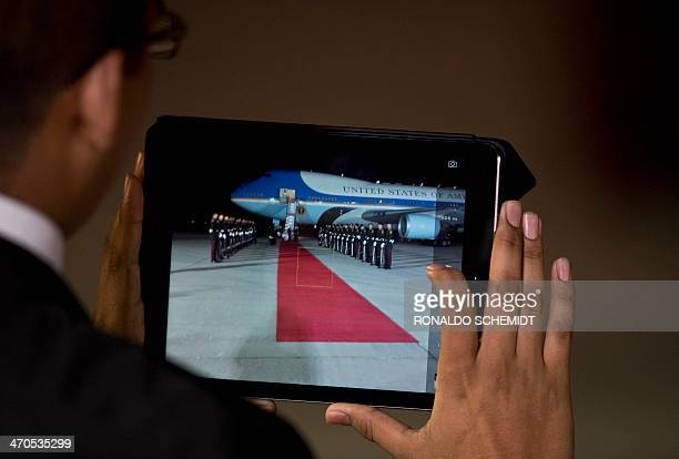 A member of the Mexican presidential security takes picture with an iPad of Air Force One before departing the Adolfo Lopez Mateos international...