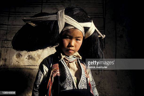 A member of the Miao ethnic minority group sports a traditional headdress September 1993 in Guizhou Province China The Miao are a linguistically...
