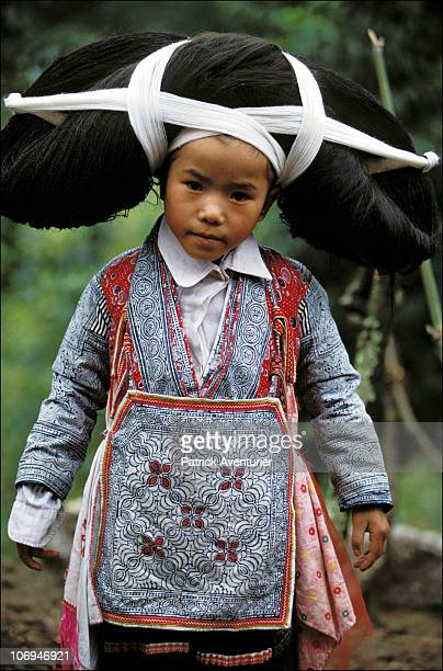 A member of the Miao ethnic minority group sports a traditional headdress in their village September 1993 in Guizhou Province China The Miao are a...