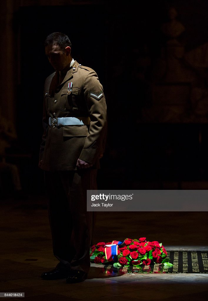 A member of the military stands at the Grave of the Unknown Warrior during a vigil to commemorate the centenary of the Battle of the Somme at Westminster Abbey on July 1, 2016 in London, England. The overnight vigil is being held to remember those who died in the Battle of the Somme which began 100 years ago on July 1st 1916. Armies of British and French soldiers fought against the German Empire and over one million lives were lost. The Grave of the Unknown Warrior contains the body of an unidentified British solider from the First World War buried in French soil and covered with a Belgian marble slab.