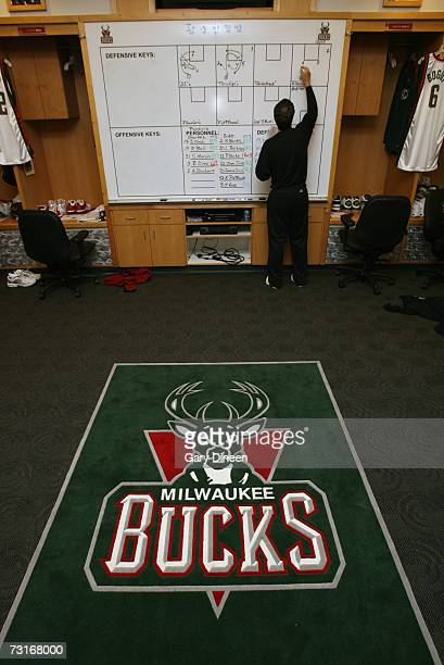 A member of the Milwaukee Bucks staff writes on the locker room board prior to the game against the Phoenix Suns at the Bradley Center on January 26...