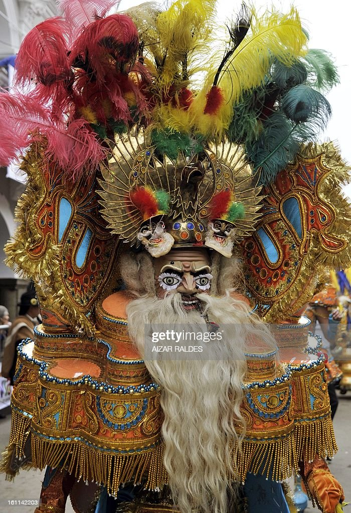 A member of the Morenada Central Cocanis de Oruro brotherhood takes part in Carnival of Oruro, in the mining town of Oruro, 240 km south of La Paz on February 9, 2013. The Carnival of Oruro was inscribed by UNESCO on the Representative List of the Intangible Cultural Heritage of Humanity in 2008.