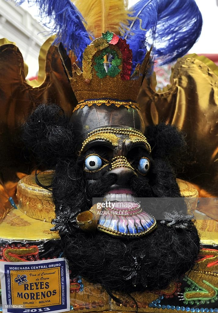 A member of the Morenada Central Cocanis de Oruro brotherhood takes part in Carnival of Oruro, in the mining town of Oruro, 240 km south of La Paz on February 9, 2013. The Carnival of Oruro was inscribed by UNESCO on the Representative List of the Intangible Cultural Heritage of Humanity in 2008. AFP PHOTO/AIZAR RALDES