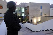 A member of the Moroccan special forces guard stands outside of the Central Bureau of Judicial Investigation building on March 23 2015 during a press...