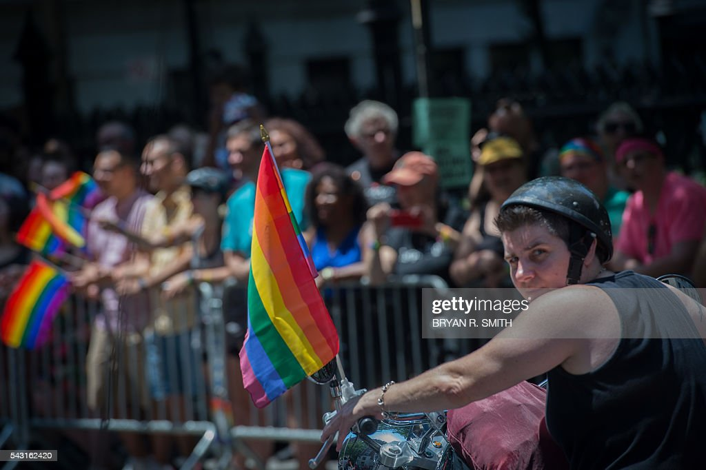 A member of the motorcycle group The Sirens rides in the 46th annual Gay Pride march June 26, 2016 in New York. New York kicked off June 26 what organizers hope will be the city's largest ever Gay Pride march, honoring the 49 people killed in the Orlando nightclub massacre and celebrate tolerance. / AFP / the 46th / Bryan R. Smith