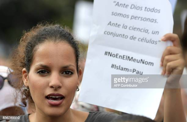 A member of the muslim community demonstrates at Plaza de Catalunya in Barcelona on August 21 2017 to protest against terrorism four days after the...
