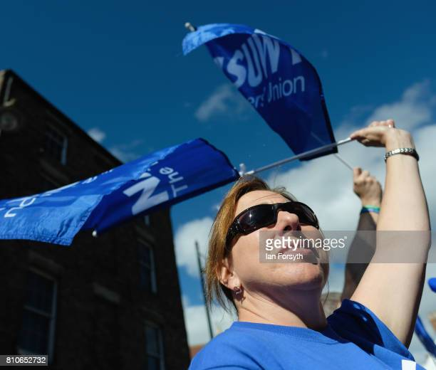 A member of the NASUWT teachers union waves her flag during the 133rd Durham Miners Gala on July 8 2017 in Durham England Over two decades after the...