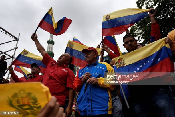Member of the National Assembly of Venezuela Diosdado Cabello holds a flag of Venezuela during a rally to support Venezuelan President Nicolas Maduro...
